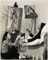 Photograph of Gala and Salvador Dalí while the artist was creating one of his works.