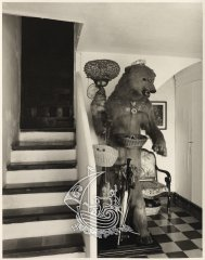 A photograph of Salvador Dalí's House in Portlligat, as can be found now. In the image we see the figure of a bear, made by Salvador Dalí, next to a staircases.