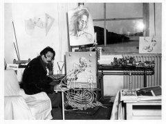 Dalí, painting a picture at his house in Portlligat.
