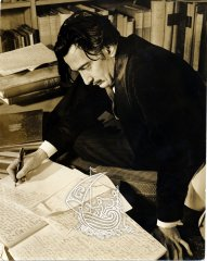 Photograph of Salvador Dalí writing a book.