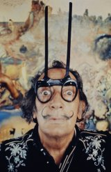 Dalí in front of his artwork Tuna Fishing (1966-1967). Photo Robert Whitaker
