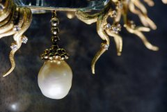 Picture detail of one hanging pearl from Daphne, a jewel designed by Salvador Dali in 1967
