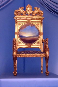 Photography of Dalí's Throne, part of the furniture of Gala and Dalí's Castle in Púbol. It's a chair with a picture on its back.