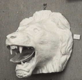 Untitled. Head of roaring lion with open mouth with a plate of fried eggs in its mouth
