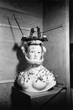 Retrospective Bust of a Woman Devoured by Ants and Spoons